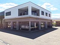 Wohn- und Geschäftshaus Romont  TissoT Immobilien